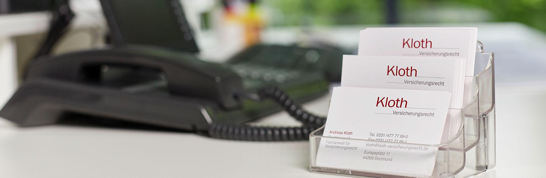 Visitenkarten und Telefon